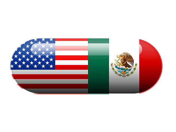 American and Mexican pill A pill with the Amercan and Mexican flag wrapped around it drug cartel stock pictures, royalty-free photos & images