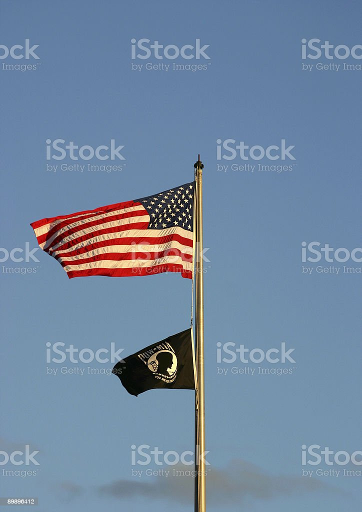 American and POW Flags Blowing royalty-free stock photo