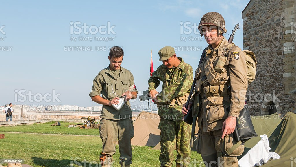 American and Russian soldiers relax in a reconstituted military royalty-free stock photo