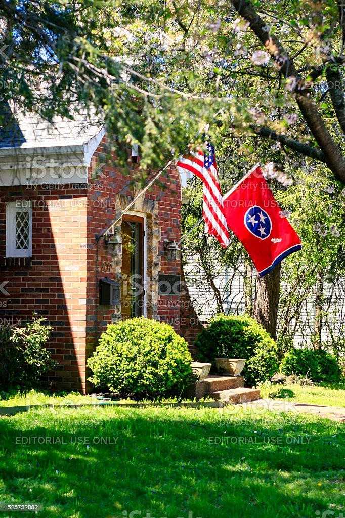 American and Tennessee state flags outside a house in Franklin stock photo