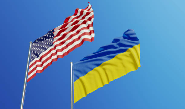 american and ukrainian flags waving with wind - ukraine stock pictures, royalty-free photos & images
