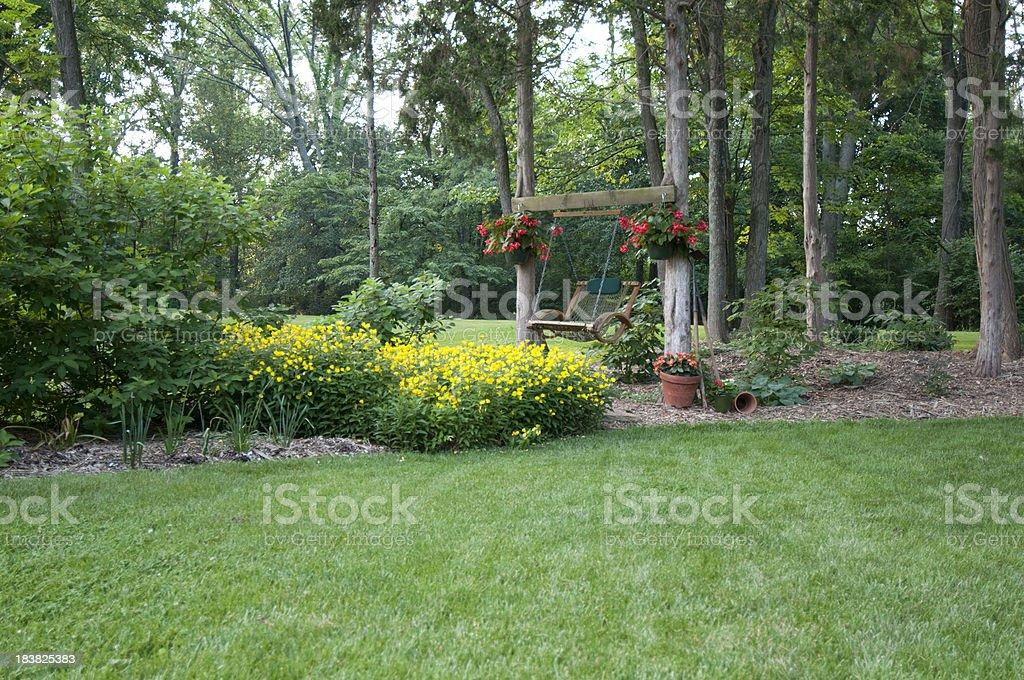 American backyard garden with swing royalty-free stock photo