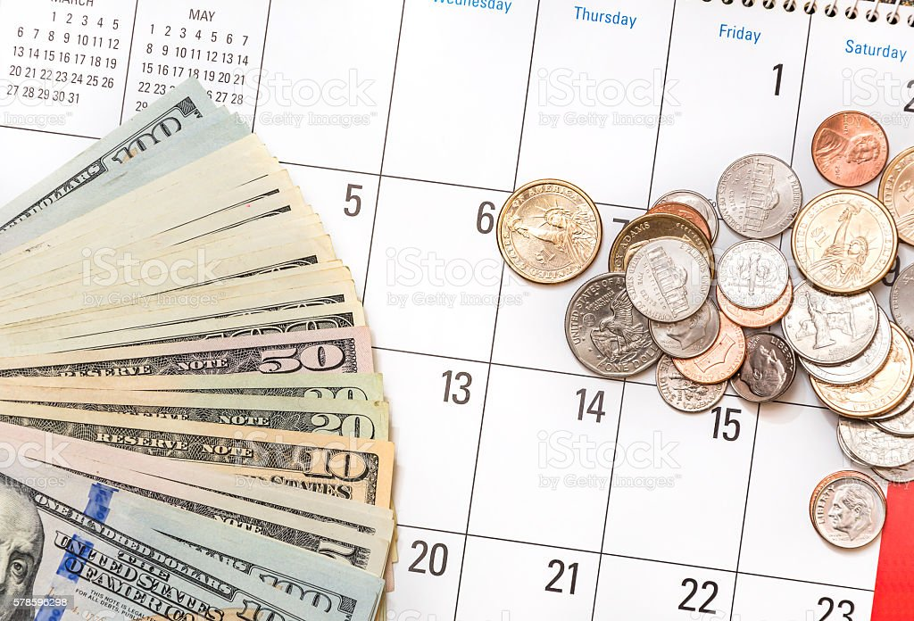 Keeping change by a calendar to keep track of payment plans for affordable bail bonds