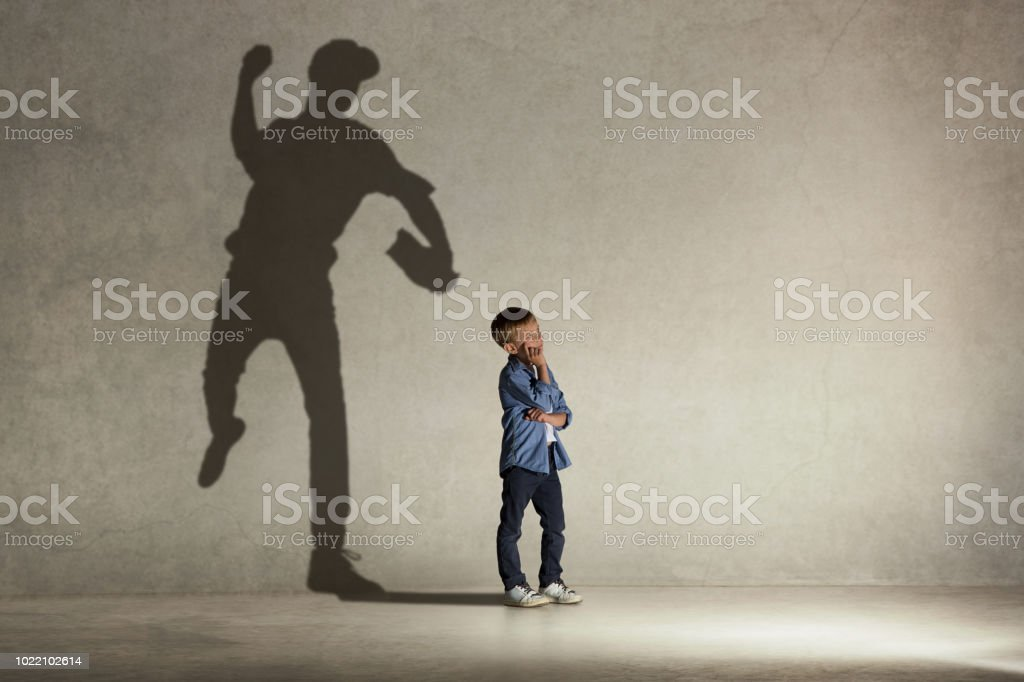American baseball champion American baseball champion. Childhood and dream concept. Conceptual image with boy and shadow of fit athlete on the studio wall Adult Stock Photo
