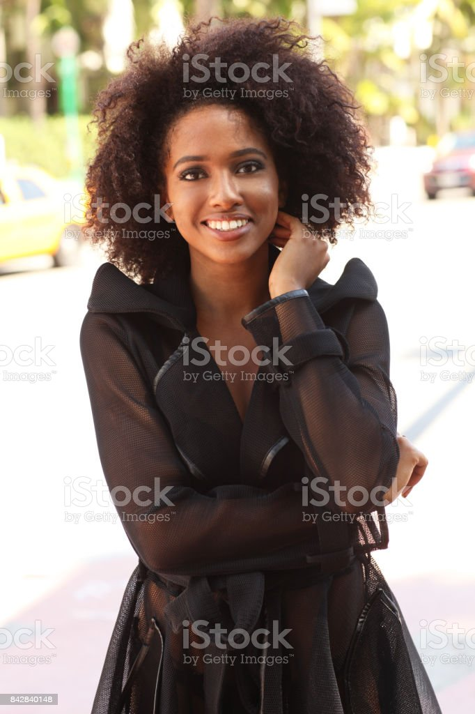American beauty with curly hair. stock photo