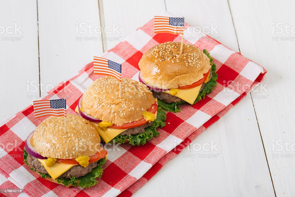 Close -up photo ,american beef burgers with cheese and USA flags, on...