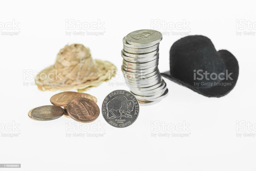 American bison nickel with cowboy hat, strawhat and coins royalty-free stock photo