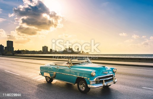 American blue 1953 convertible convertible vintage car on the promenade Malecon in the evening sun in Havana City Cuba - Serie Cuba Reportage