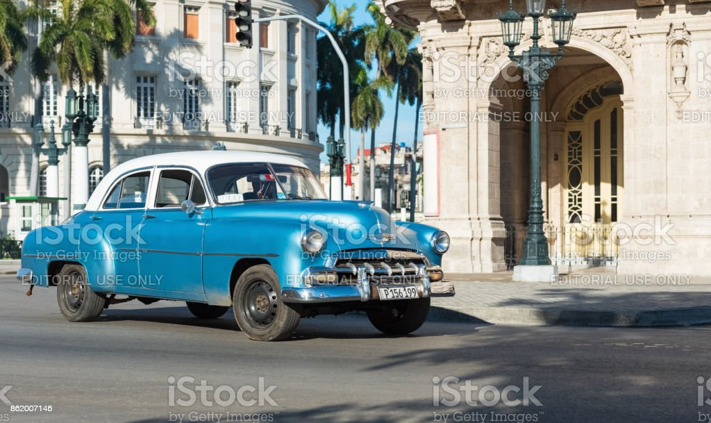 American blue Chevrolet classic car with white roof drived on the main street in Havana City Cuba - Serie Cuba Reportage stock photo