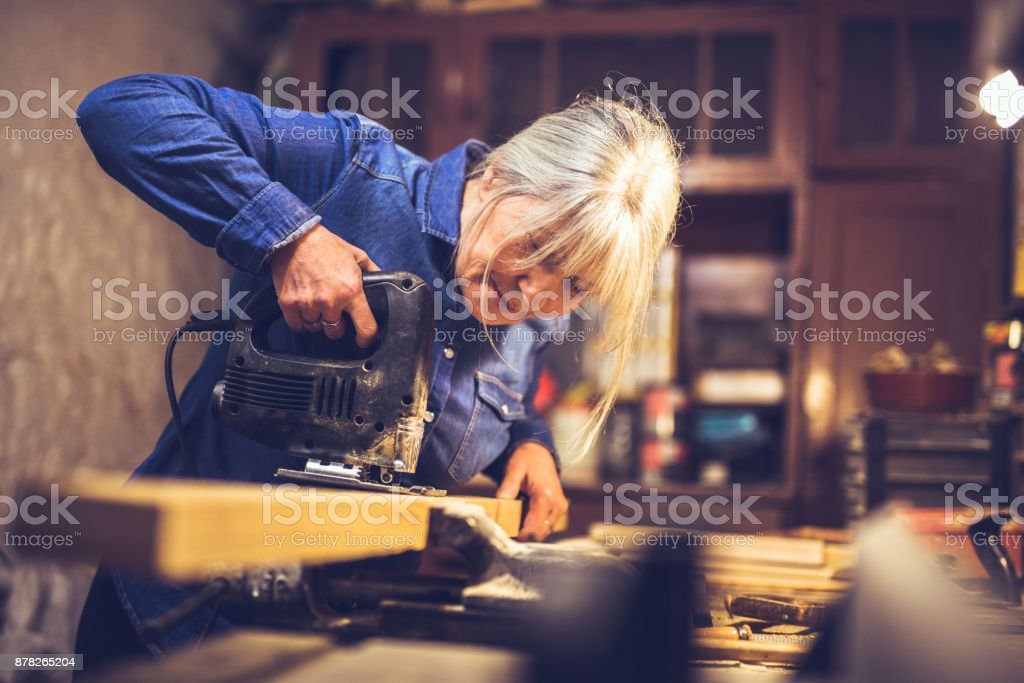 American blue collar worker in a workshop stock photo