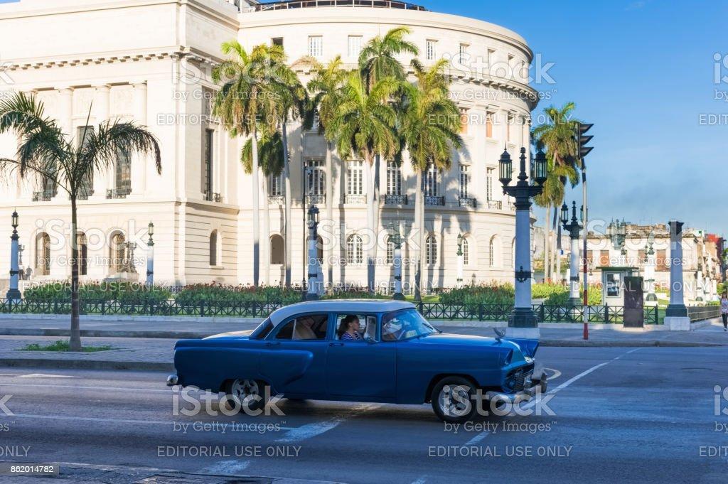 American blue Pontiac classic car drive before the Capitolio on the main street in Havana City Cuba - Serie Cuba Reportage stock photo