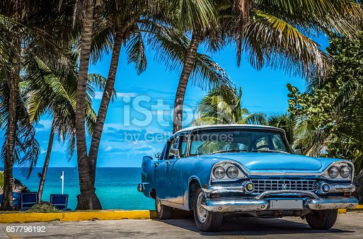 HDR - American blue beautiful vintage cars parked under palms in Varadero Cuba near the beach - Serie Cuba Reportage