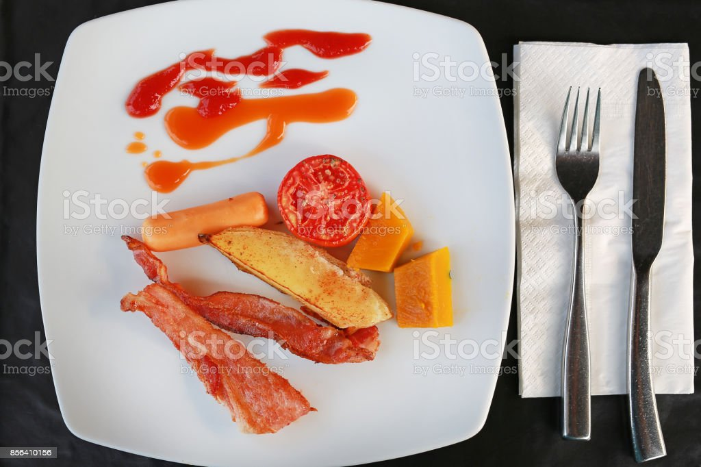 American breakfast, with vegetables, beacon and sausage. stock photo