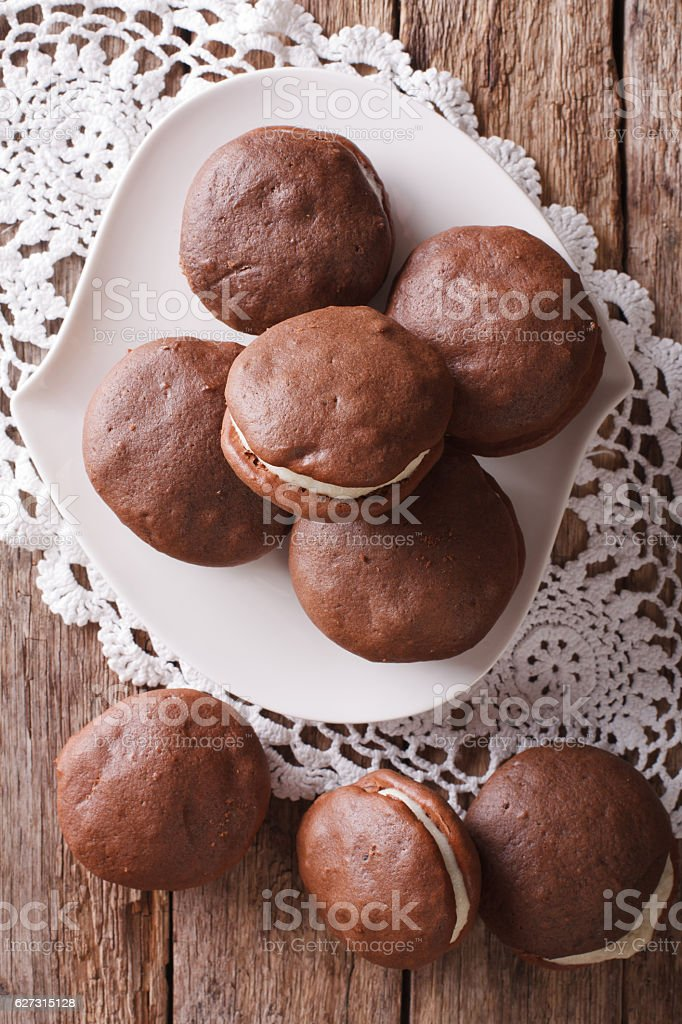 American cakes Whoopie pie close-up on the table. vertical stock photo