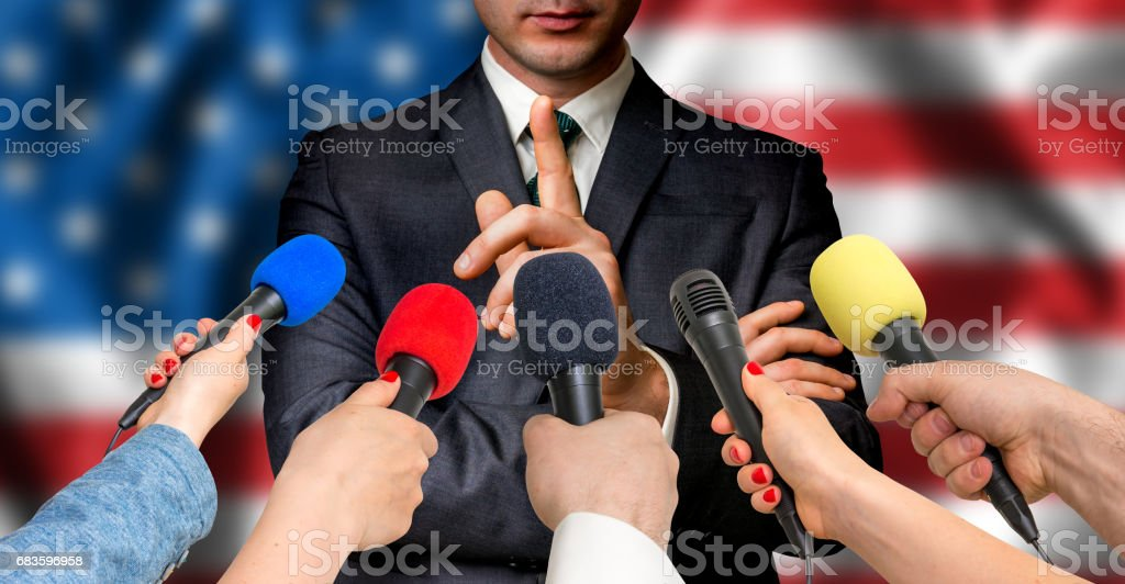 American candidate speaks to reporters - journalism concept stock photo