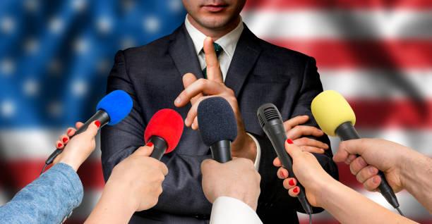 american candidate speaks to reporters - journalism concept - выборы президента стоковые фото и изображения