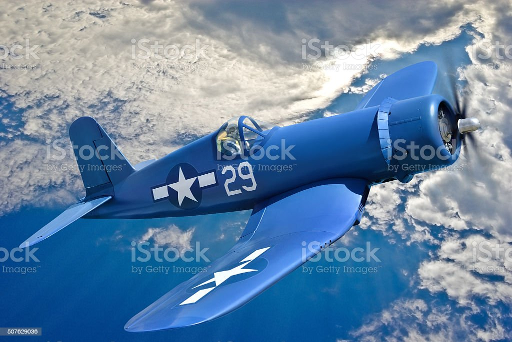 American carrier-based fighter aircraft is flying against the blue sky stock photo