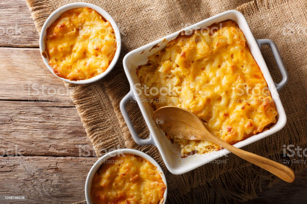 American casserole macaroni and cheese in baking dish close up. Horizontal top view stock photo