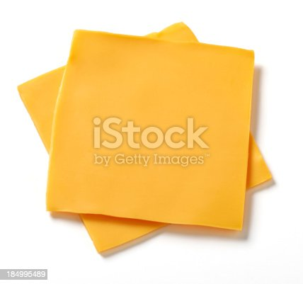 Two slices of processed American cheese on white background with natural shadow.