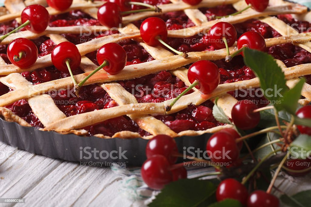 American cherry pie close up on the table. horizontal stock photo