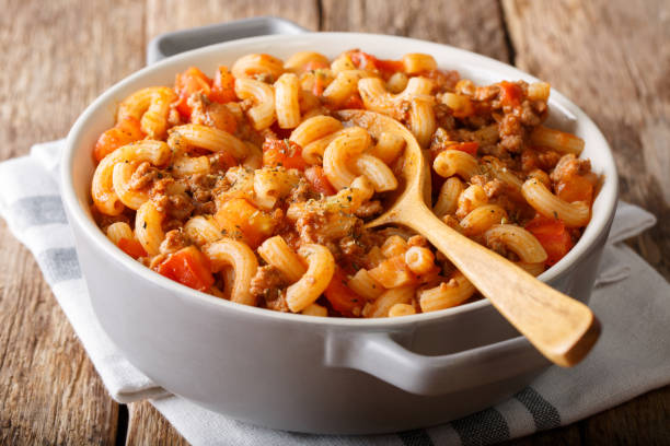 american chop suey, american goulash, with elbow pasta, beef and tomatoes close-up. Horizontal stock photo