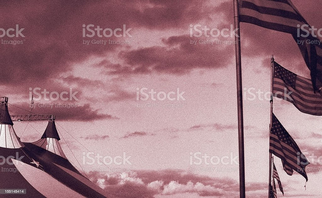 Circus tent with American colours and flags. Film grain visible