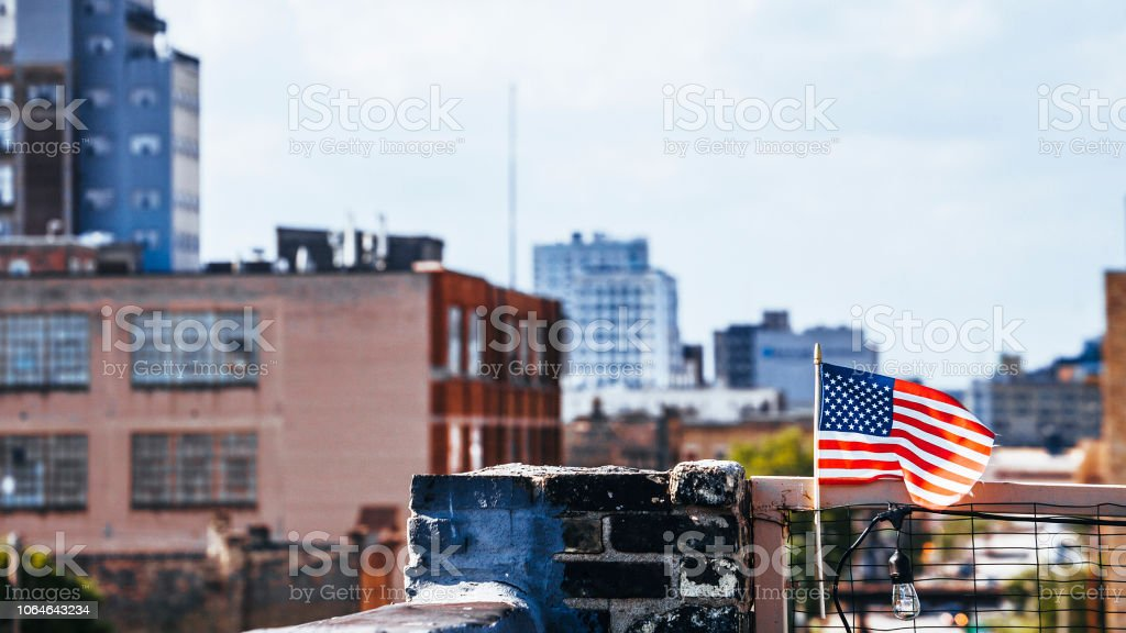 American city and American flag - Milwaukee, Wisconsin stock photo