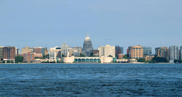American city skyline and architecture background. Cloudy blue sky over downtown with capitol state building and Monona terrace. Summer view across the lake Monona. City of Madison, the capital of Wisconsin, Midwest USA. madison wisconsin stock pictures, royalty-free photos & images