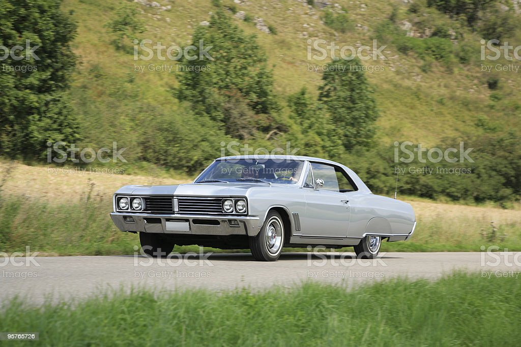 American Classic Car Driving  Through Nature Landscape stock photo