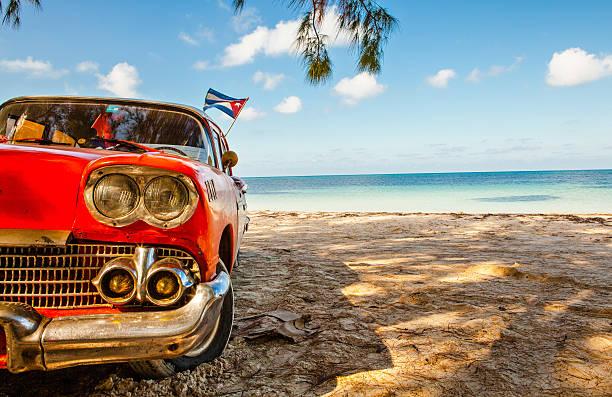american classic car on the beach cayo jutias - cuba stock photos and pictures