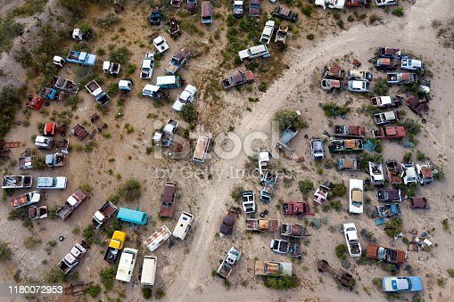 Wrecked, legendary, American classic cars on a junkyard, aerial view, Arizona, USA.