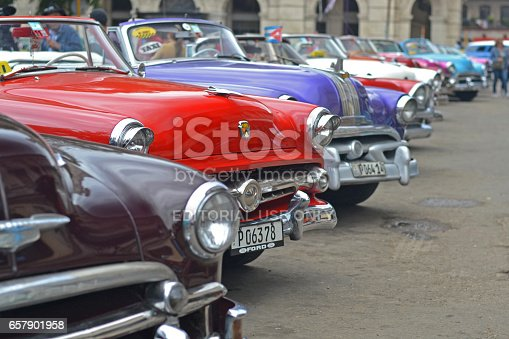 Havana, Cuba - January, 19th, 2016: American classic cars stopped on the street in Havana. These cars are the ones of the most wanted and rare classic cars with 50s.