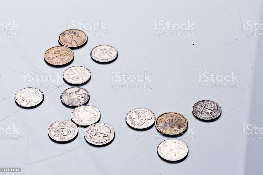 American coins scattered on a gray background royalty-free stock photo