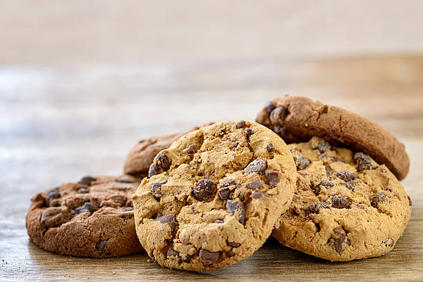 american cookies american cookies on wooden table chocolate chip cookie stock pictures, royalty-free photos & images