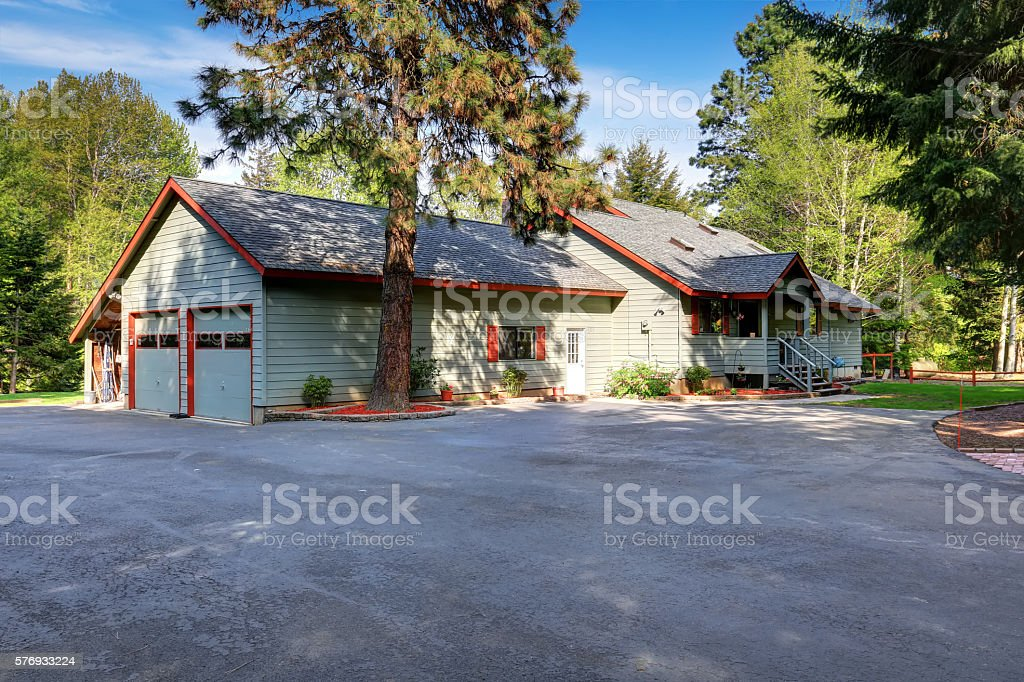American country house exterior with wide asphalt driveway . stock photo