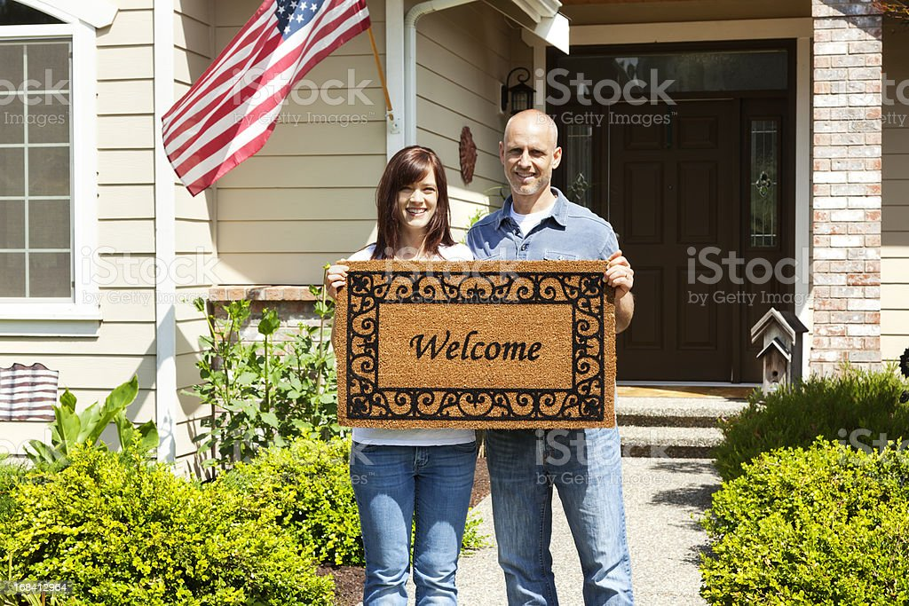 American Couple at Home with Welcome Mat stock photo