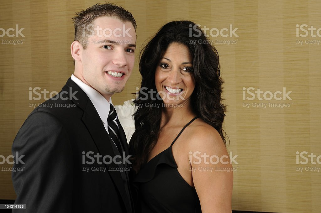 American Couple Older Woman Younger Man Wearing Formal Clothing stock photo