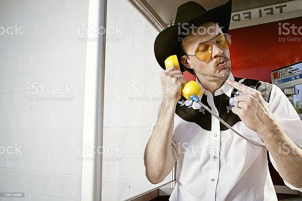 American Cowboy At Payphone royalty-free stock photo