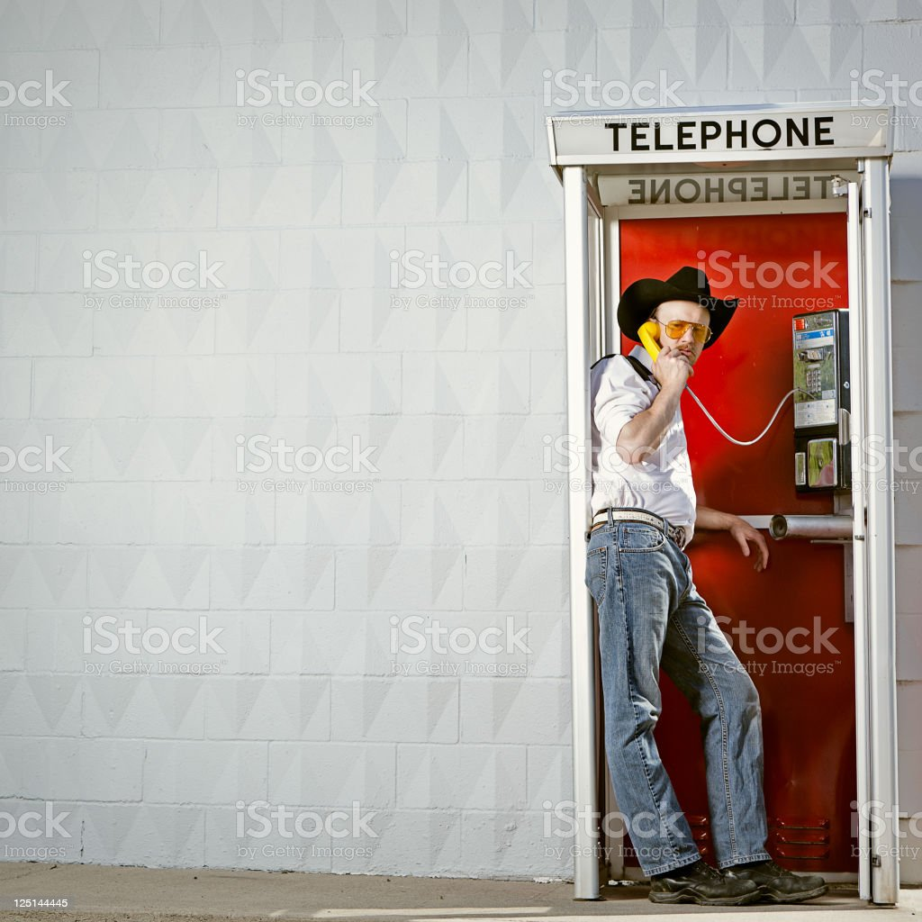 American Cowboy, Grumpy At Payphone royalty-free stock photo