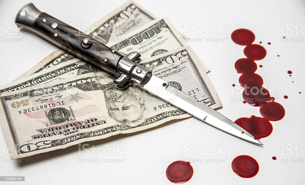 American Criminal Switchblade knife US money and blood splatters stock photo