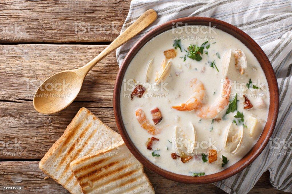 American cuisine: New England clam chowder soup closeup. horizontal top view stock photo