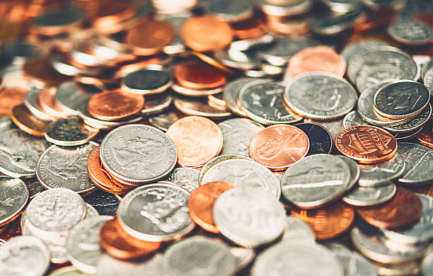 American currency coins background American currency coins background bringing home the bacon stock pictures, royalty-free photos & images