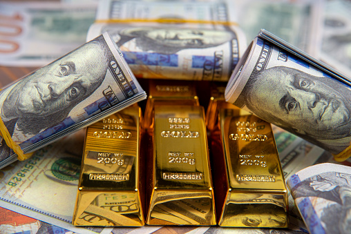 American currency Dollar and Gold ingot combinations. Close up for dollar and gold ingot