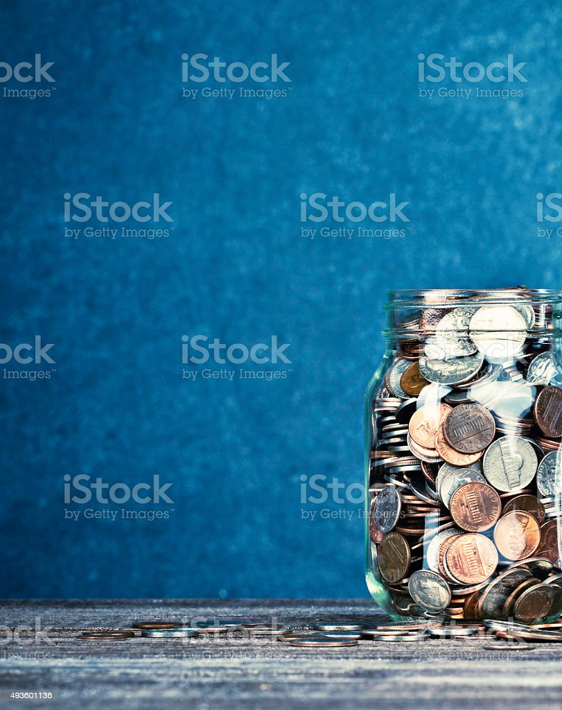 American currency money jar with copyspace. Fundraising and donations. stock photo
