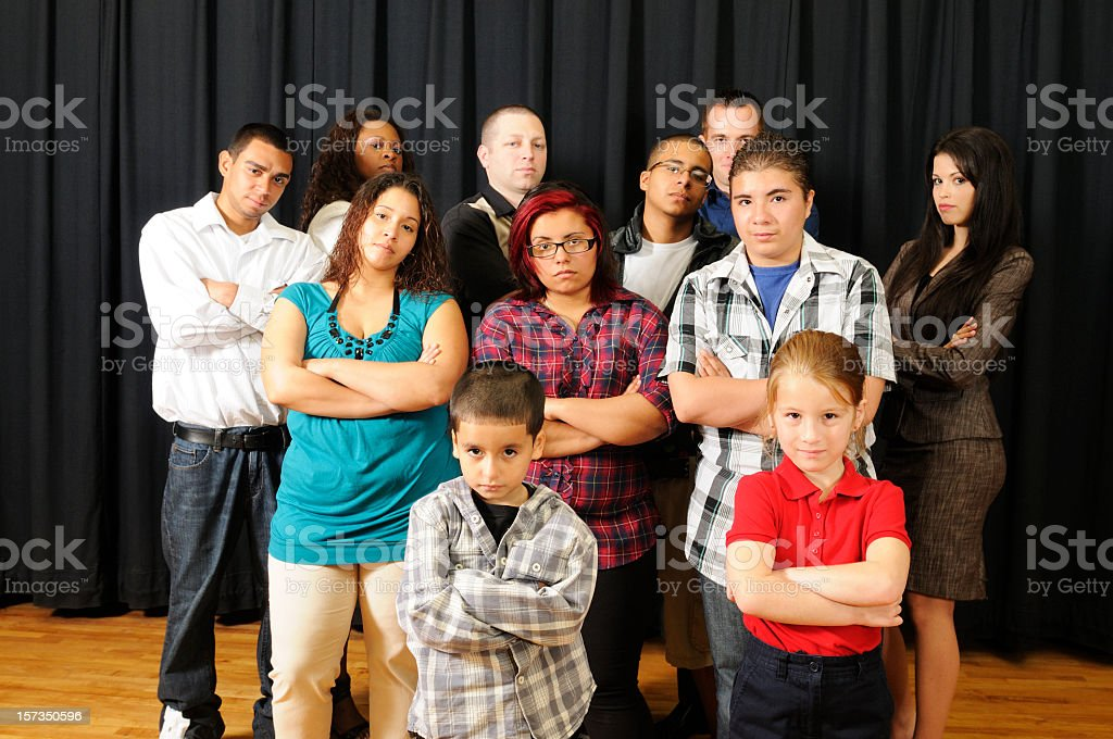 American Diversity Mixed Age Group Standing Together Looking Tough stock photo
