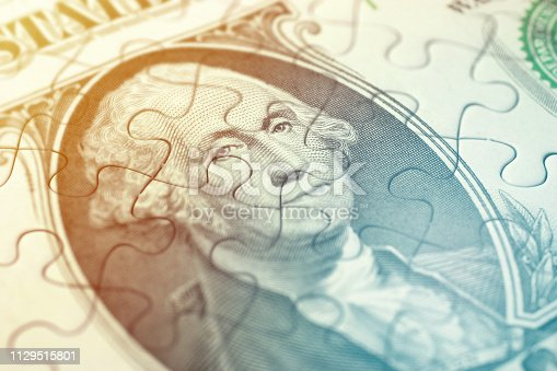 Close-up of puzzle of American dollar bill.