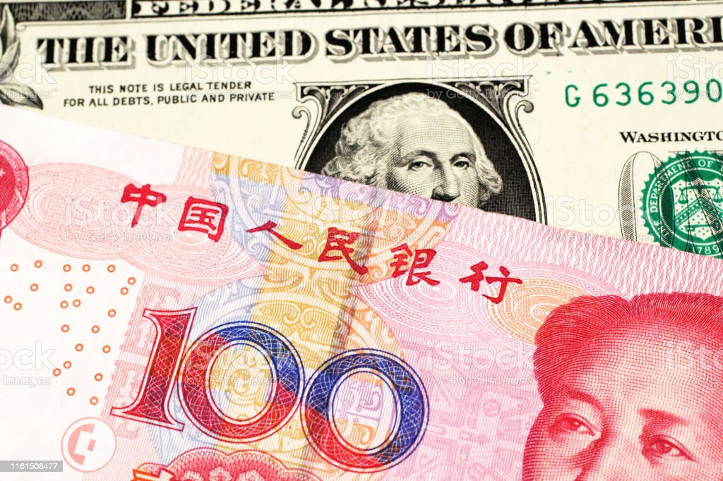 American Dollar Bill With A Yuan Note From China Stock Photo Download Image Now Istock