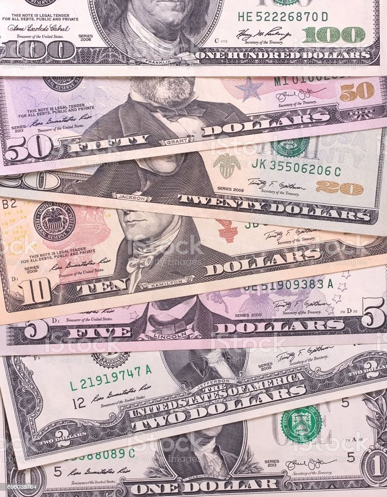 American dollar bills of different denominations abstract background. stock photo