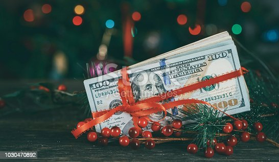 istock American dollars as a Christmas gif t or a Christmas spending concept 1030470892