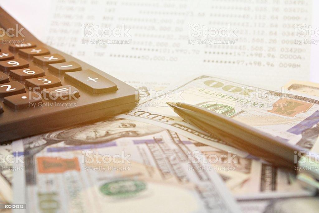 American Dollars cash money, calculator on savings account passbook or financial statement stock photo